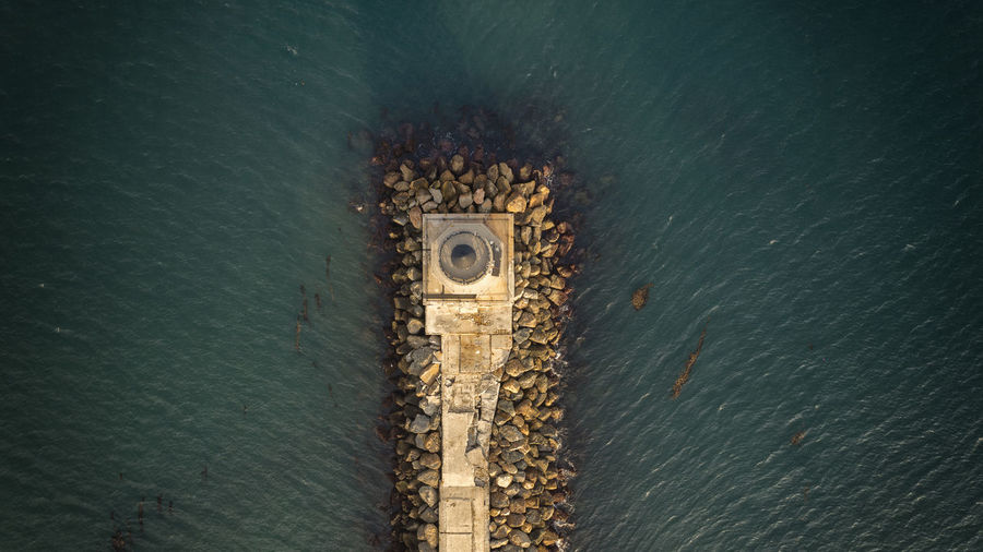 Aerial view of lighthouse at sea