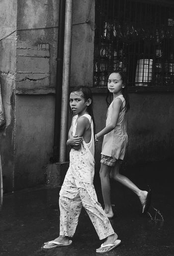 Two Girls Walking In The Rain Cold Rainy Day Philippines Black And White Splash