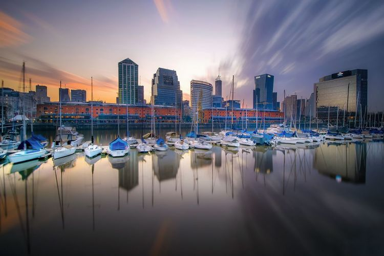 Architecture Boat Built Structure City City Life Cityscape Cloud Cloud - Sky Development Harbor Long Exposure Mast Mode Of Transport Modern Nautical Vessel No People Office Building Outdoors Reflection Sky Skyscraper Sunset Tall - High Urban Skyline Water