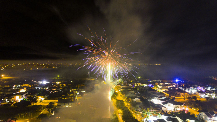 Architecture Arts Culture And Entertainment Blurred Motion Building Exterior Built Structure Celebration City Cityscape Event Exploding Firework Firework - Man Made Object Firework Display Glowing Illuminated Long Exposure Low Angle View Motion Multi Colored Night No People Outdoors Sky Go Higher