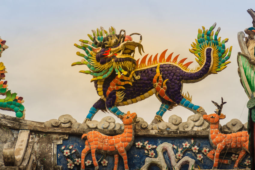 Chinese dragon-headed unicorn statue on the temple roof. Kylin or Kirin on roof in Chinese temple. Chinese Temple Ancient Architecture Dragon Sculpture Kirin Statue Kylin Temple Roof Architecture In Thailand Unicorn Unıcorn Animal Representation Architecture Art And Craft Belief Chinese Dragon Chinese Temple Chinese Temple Decoration Chinese Temples Craft Creativity Day Dragon Dragon Head Dragon Scale Dragon Scales Dragon Statue Dragon Statues Kirin Kyline Low Angle View Multi Colored Nature No People Ornate Religion Representation Sculpture Sky Spirituality Statue Temple Roof Temple Roof Tile Temple Roofs Unicorns
