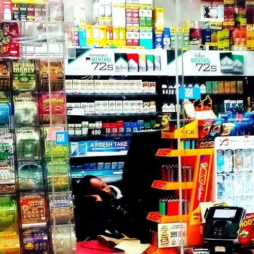 late nights are hard work Lotto Tickets LateNightShifts Sleeping On The Job Busted Shop Store Window Information Display Retail Display Window Display Shelves Colorful Price Tag Collection Window Shopping Various Board Signboard Vending Machine Stories From The City
