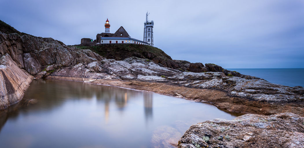 Bretagne Brittany France Rock Formation Saint-Mathieu Lighthouse Water Reflections Architecture Beauty In Nature Building Exterior Guidance Guidance For Boats Landscape Lighthouse Marine Nautical Phare Rock - Object Scenics Sea Water