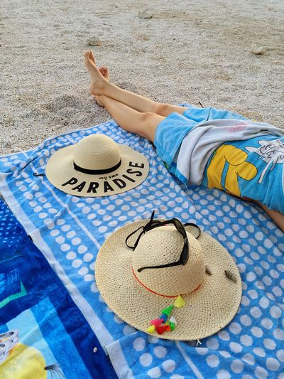 Hat Vacations Beach Sand Summer Leisure Activity One Person Sun Hat Blue Outdoors Relaxation Day Lying Down Real People People Adult Badqualityrecords Rock Lifestyles Paradise Pine Beach Croatia