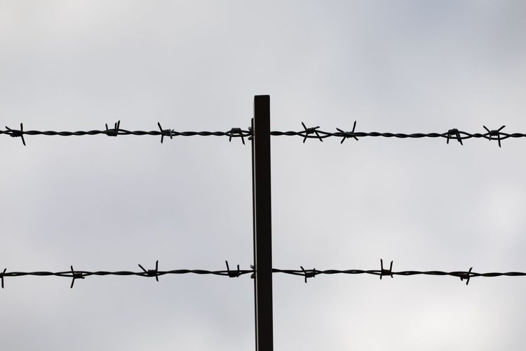Barbed wire against clear sky