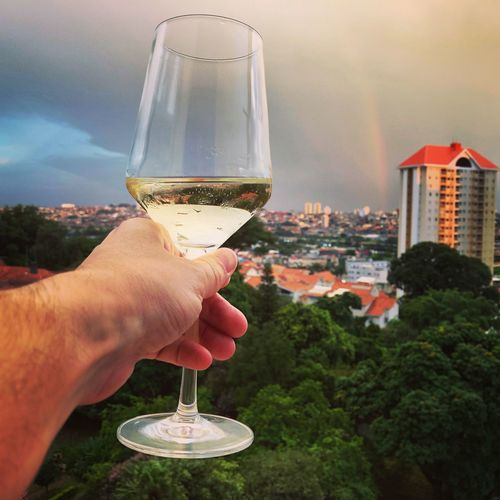 Love Rain rainbow My Life Wine moments Love Rain Rainbow My Life Human Hand Hand Wine Refreshment Drink Alcohol Holding Food And Drink Champagne Wineglass Glass Human Body Part Close-up Finger Building Exterior Real People Champagne Flute Focus On Foreground Celebration One Person