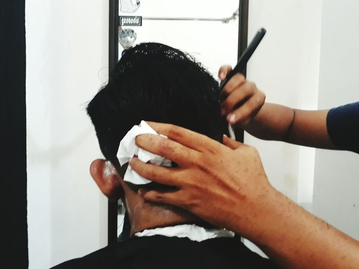EyeEm Selects Human Hand Barber Human Body Part Hairdresser Barber Shop Human Hair Hairstyle Two People Customer  Men Adult Body Care Cutting Hair Occupation Combing Razor Lifestyles Fashion Working Only Men