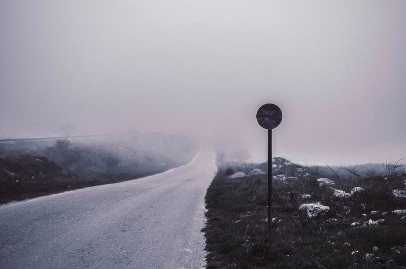 Empty country road in a foggy day