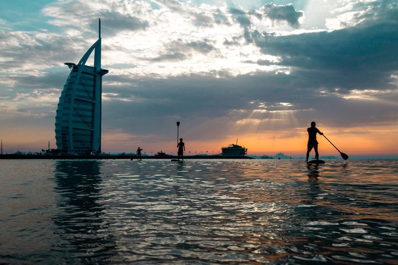 Sunset Water Silhouette Sky Waterfront Cloud - Sky Sea Real People Nature Men One Person Outdoors Scenics Beauty In Nature Nautical Vessel Day People Dubai Adventures In The City