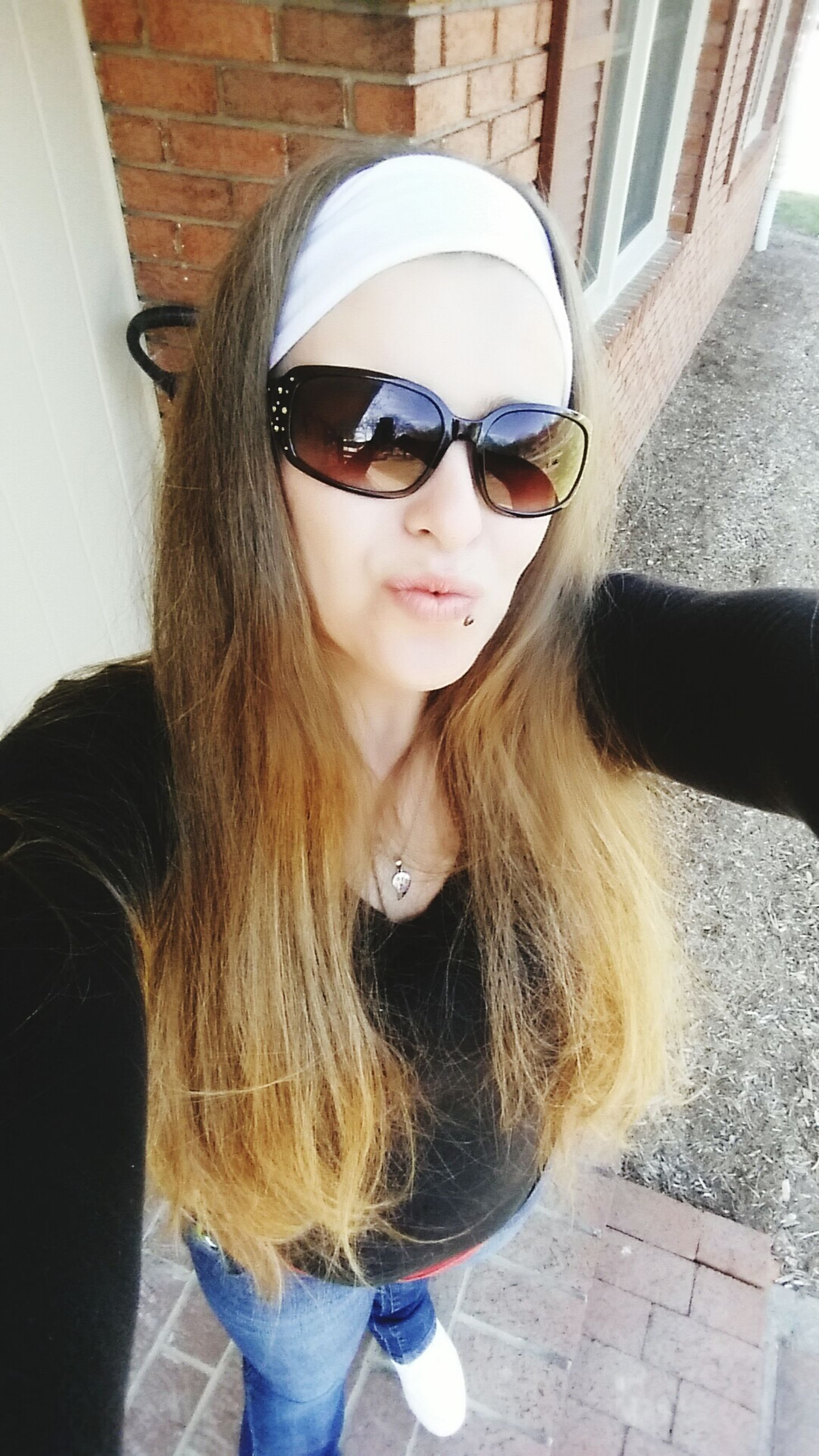 sunglasses, lifestyles, young adult, leisure activity, young women, person, long hair, portrait, front view, casual clothing, looking at camera, headshot, blond hair, day, smiling, sunlight, transportation