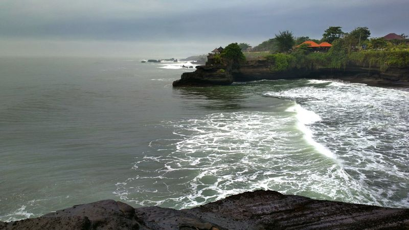 Tanah Lot. TheFoneFanatic Nokia808 Phone Photography Mobile Photography The Week On EyeEm Wave Tides Nature Beach Landscape Vacations Beautiful Sky Sea Scenics Rock - Object Tanah Lot Perspectives On Nature