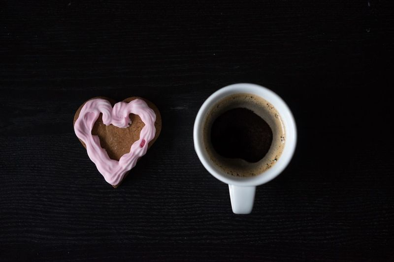 Cup of Black Coffee With Heart Shape Cookie