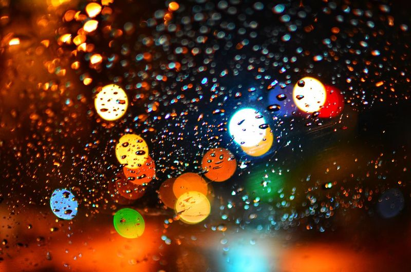 Abstract circular bokeh background of light. Wallpaper Background Bokehlicious Bokeh Photography Design Night Bokeh Color Lamp Town City Rain RainDrop Multi Colored Illuminated Backgrounds Abstract Defocused Party - Social Event Close-up Wet Focus Pattern Water Drop