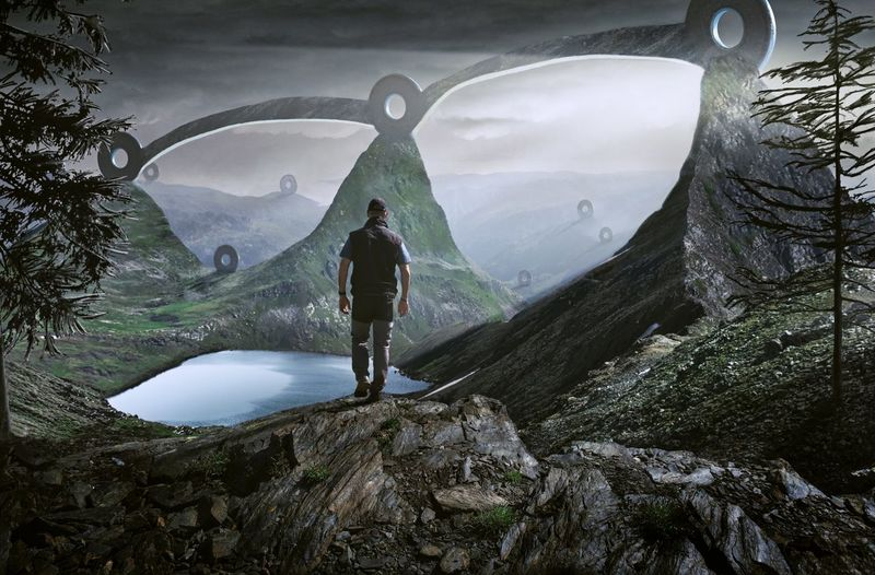 Digital Composite Image Of Man Standing On Rock Against Mountains