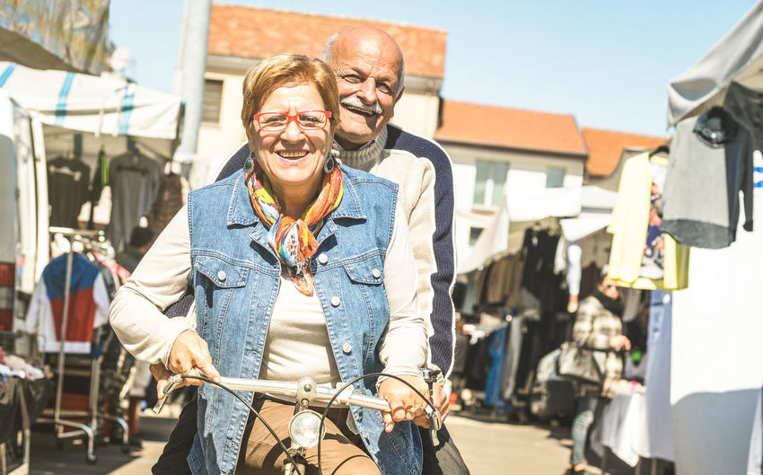Senior retired couple having genuine fun together riding bike - Happy mature people on healthy elderly concept - Pensioner sharing time with bicycle Senior Couple Retired Mature Old Older  Elder Having Fun Fun Love Youthful Lifestyles People Outdoors Pension Active Vacation Travel Bike Bicycle Playful Healthy Happy Family Bycicle