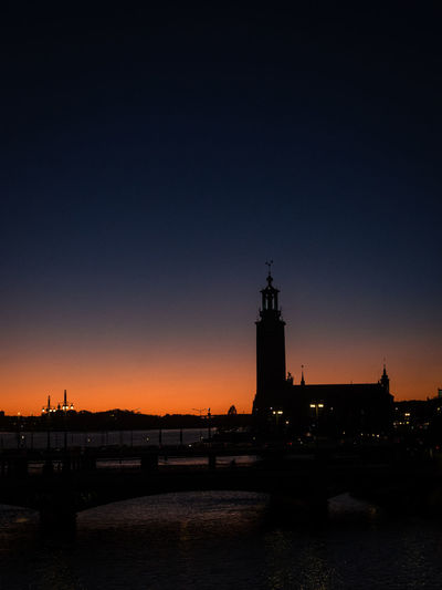 Building Silhouette Orange Sky Stadshuset Stockholms Stadshus  Architecture Bridge Building Exterior Built Structure Clear Sky Day Dusk Nature No People Outdoors Riddarfjärden Sea Silhouette Sky Stockholm City Hall Sunset Tower Water Magic Sky HUAWEI Photo Award: After Dark