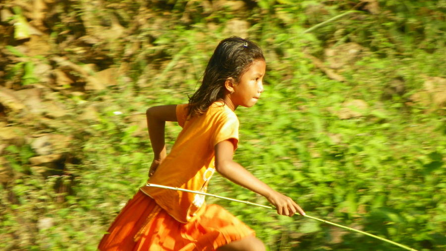 Hunting the prey! Child Childhood Children EyeEmNewHere Girl Happiness Hunting INDONESIA Long Hair Nature One Person Outdoors People Playing Running