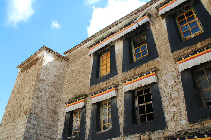 Wall with the windows in Sera Monastery at Lhasa, Tibet, China Architecture Building Exterior Built Structure Day Low Angle View No People Outdoors Sera Monastery Sky Wall Window Windows