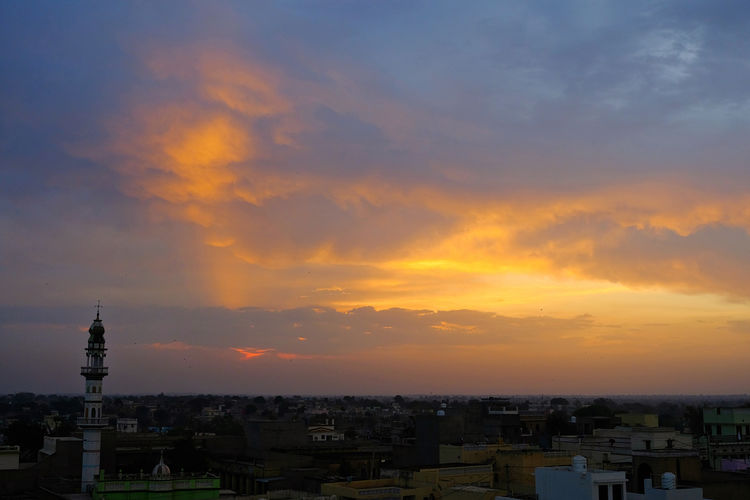 Sunset over old town old Mandawa, India. ASIA India Mandawa, Rajasthan Old Town Architecture Beauty In Nature Belief Building Building Exterior Built Structure City Cityscape Cloud - Sky Mandawa Nature No People Old City Orange Color Outdoors Place Of Worship Religion Residential District Sky Spire  Sunset Tower TOWNSCAPE Travel Destinations