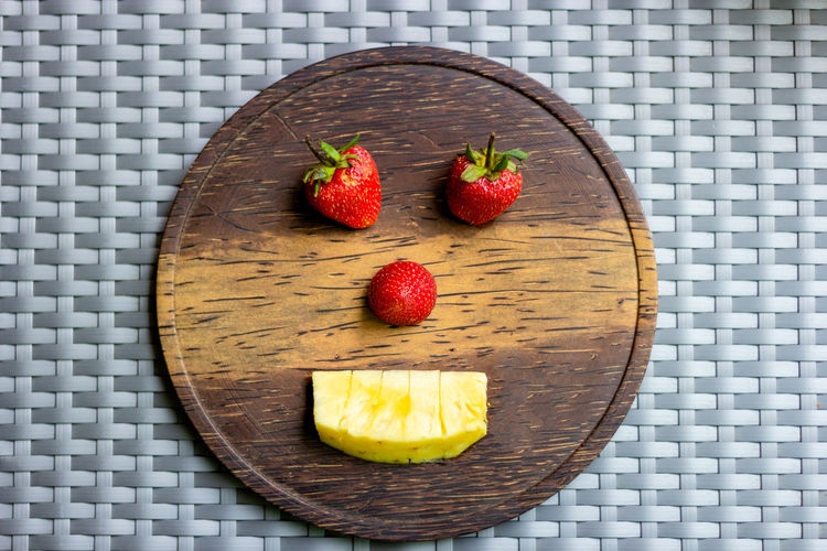 Strawberry and pineapple on wooden plate create shape a robot Food Fruit Food And Drink Healthy Eating Freshness Strawberry Berry Fruit Directly Above Wellbeing Still Life Indoors  No People Close-up Sweet Food High Angle View Table Indulgence Sweet Red Dessert Temptation Place Mat