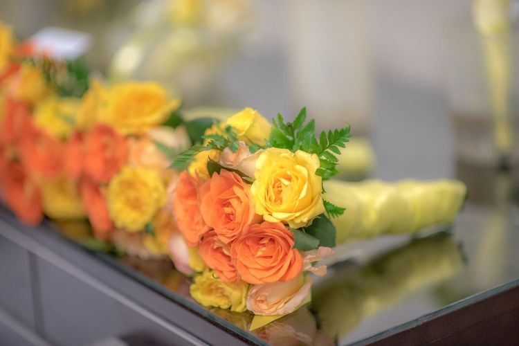 Orange and yellow rose bouquets on tabletop. Orange Yellow Orange Flower Yellow Flower Roses Wedding Flowers Flowering Plant Flower Freshness Plant Beauty In Nature Rosé Rose - Flower Flower Arrangement Arrangement Celebration Nature Focus On Foreground Close-up Bouquet Indoors