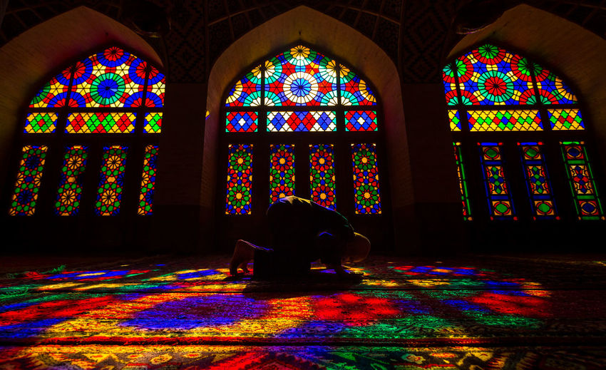 A man prays at the Nasir al-Mulk Mosque in Shiraz in Iran's Fars province November 11, 2013. Art Art And Craft Church Colourful Creativity Dark Decoration Design Elderly Historical Building Human Representation Indoors  Iran Mosque Ornate Place Of Worship Pray Religion Shiraz, Iran Shīrāz Silhouette Solo Spirituality Statue Travel
