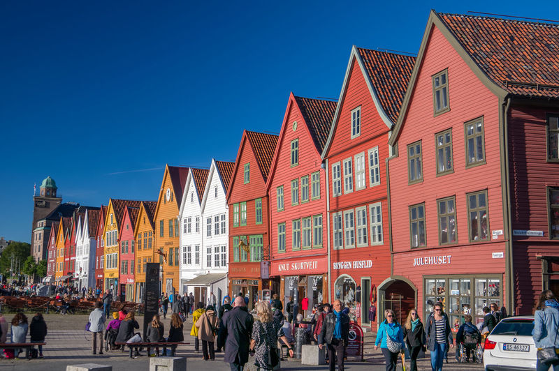 Architecture Bergen Blue Bryggen Bryggen I Bergen Building Building Exterior Built Structure City City Life Crowd Day Europe Group Of People Large Group Of People Leisure Activity Lifestyles Mixed Age Range Norway Outdoors Sky Tourist Travel Travel Destinations Travel Photography