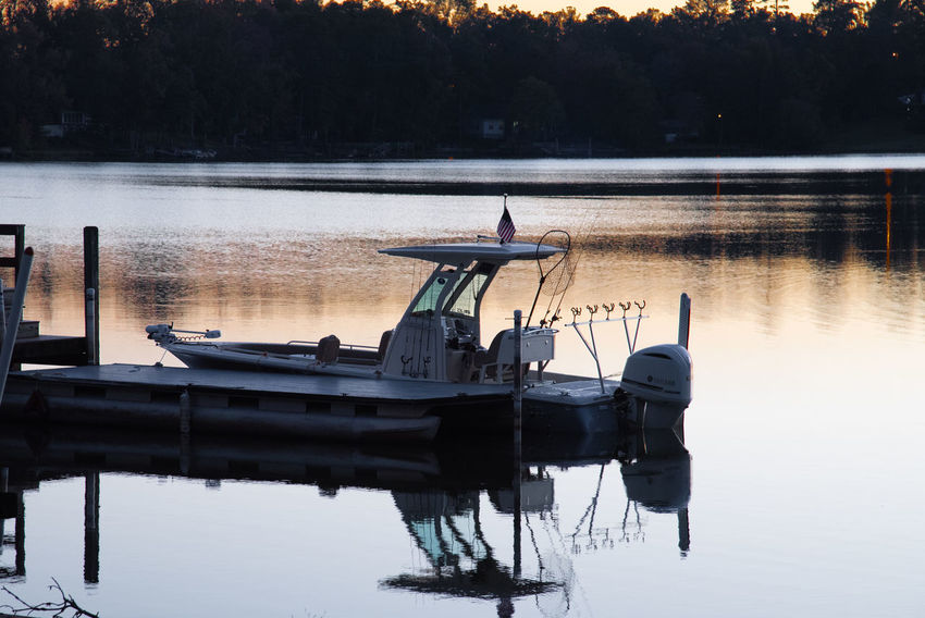Water Reflection Lake Nautical Vessel Waterfront Transportation Nature Tree Tranquility Outdoors Sunset Standing Water Pier Reflections In The Water