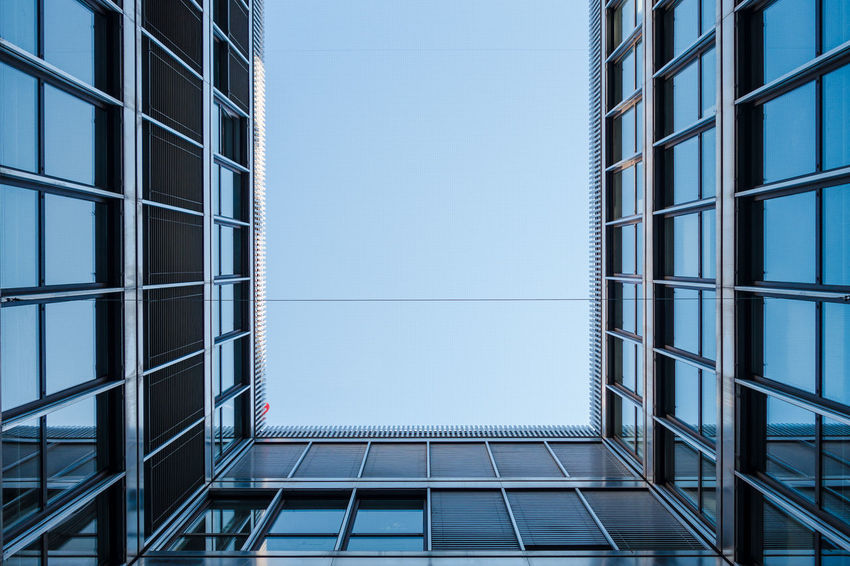 Apartment Architecture Blue Sky Building Building Story Built Structure City Clear Sky Corner Corners Diminishing Perspective Directly Below Exterior Geometric Shape Glass Glass - Material Modern Office Building Repetition Skyscraper Tall Tall - High Window