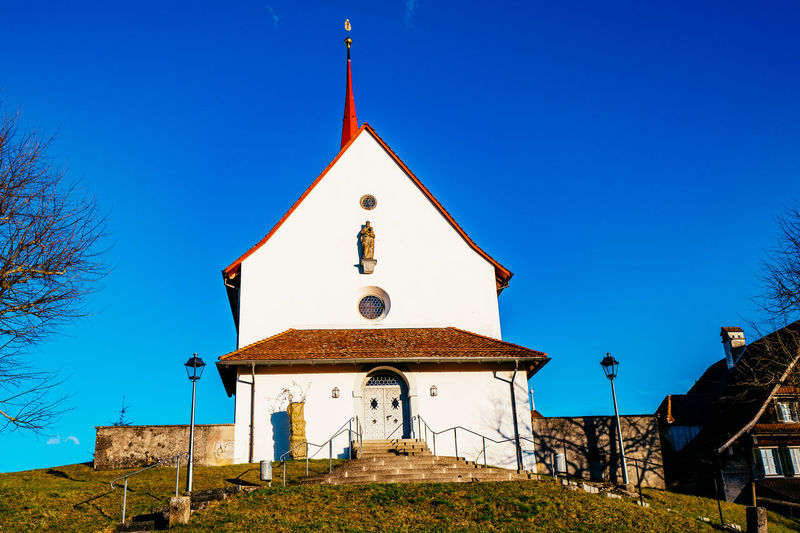 Architecture Bell Tower Blue Building Exterior Built Structure Cathedral Church Clear Sky Copy Space Cross Day Gormund Kapelle Low Angle View Outdoors Place Of Worship Religion Spirituality Sunlight Tree