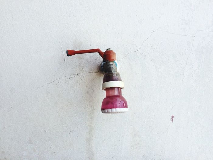 Close-Up Of Shower Head Against The Wall