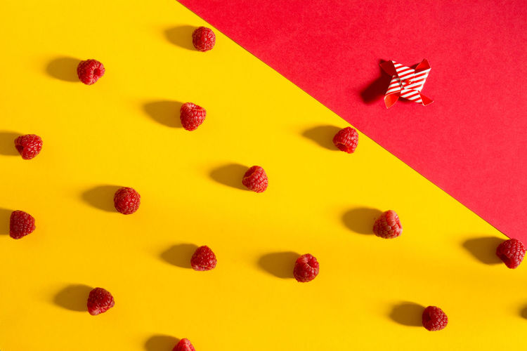 Fresh raspberries on yellow and red background, from above Collage Art Dessert Food And Drink Freshness Freshnesss Healty Food Tasty Dishes Backgrounds Berry Fruit Colofrul Color Delicious Fruits Nutrition Organic Food Overhead View Raspberry Rasperries Raw Food Red Red Color Ripe Fruit Sweet Food Top View Yellow Color