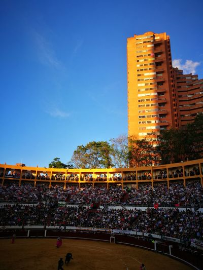 Large Group Of People People Travel Destinations Travel Photography Bogotacity Bogotá Colombia Streetphotography Bullfighting Editorialphotography Blue Day
