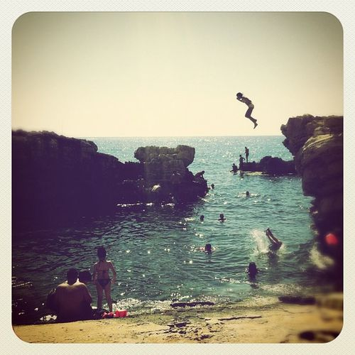 Splah ! Girl Jumping Rock beach water sunday rightnow sea water plage igerslebanon lebanon 2012 liban
