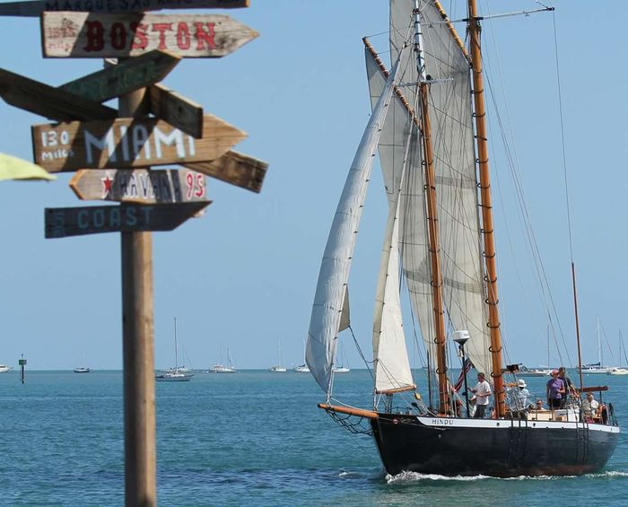 Sailboat in Key West Sailboat Key West Florida Florida Life Loving Life  Sails Up Directional Signs Gulf Of Mexico Meets Atlantic Ocean Blue Skies Blue Water