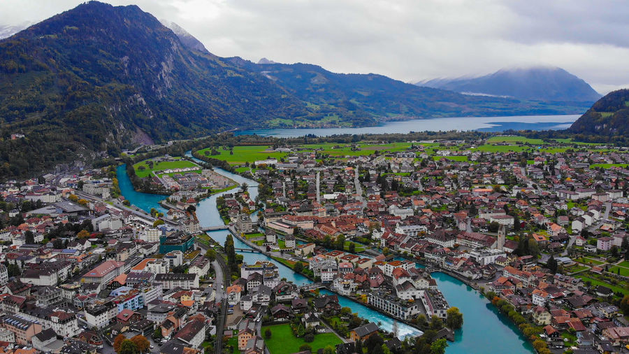 High angle view of townscape and mountains in bay