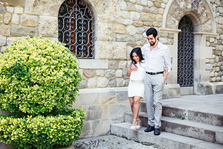 Adult Adults Only Architecture Beautiful People Beautiful Woman Beauty Bonding Building Exterior Cheerful Day Front View Full Length Happiness Heterosexual Couple Lifestyles Love Outdoors People Smiling Steps Togetherness Two People Women Young Adult Young Women