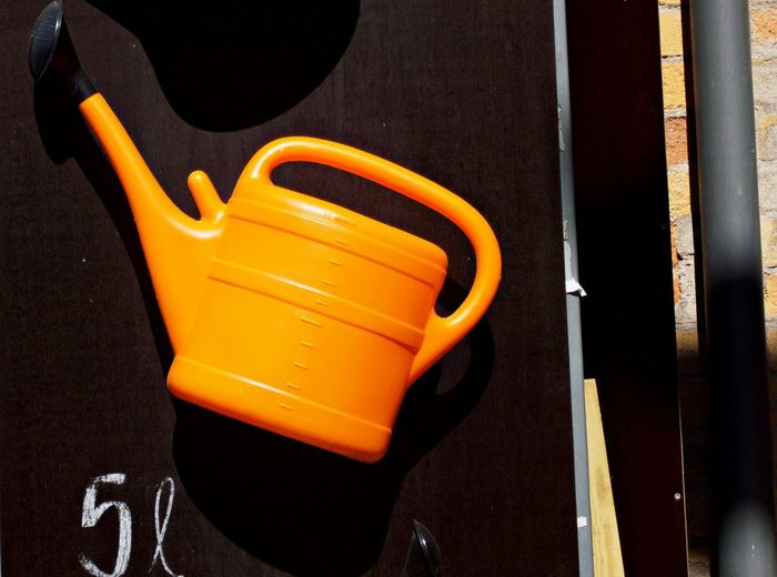 Watering Can Orange Color Close-up No People Focus On Foreground Still Life Work Tool Hand Tool Hanging High Angle View Gardening Equipment Let It Rain Equipment Day