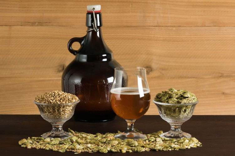 Beer Making Ingredients And Beer Jug On Table