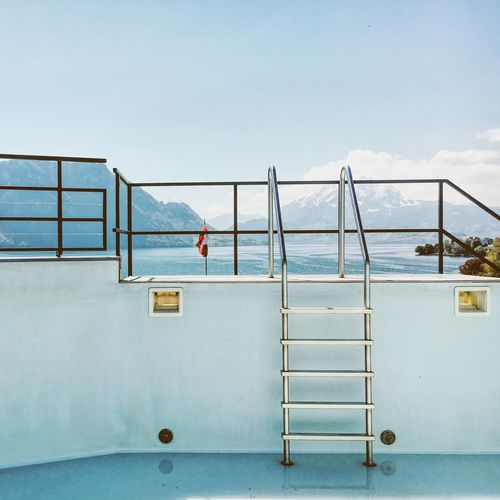 Steps Of Swimming Pool With Mountain Range In Background