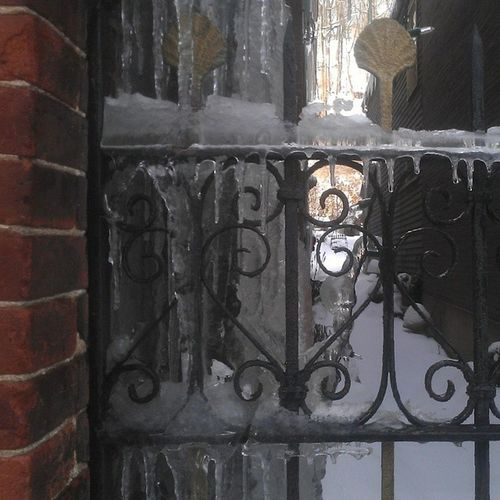 Alley iron gate Victorian Wroughtiron Finials Copper  brick alley ice snow mauchchunk historical downtown mansion Poconos