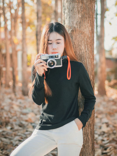 Woman with camera outdoors