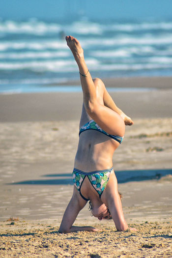 Balance Beauty In Nature Clothing Day Exercising Full Length Handstand  Healthy Lifestyle Land Leisure Activity Lifestyles Nature One Person Outdoors Real People Sand Sea Swimwear Water Inner Power EyeEmNewHere Handstand  Summer Exploratorium