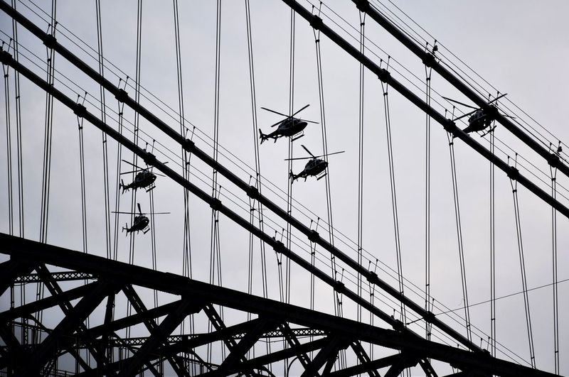Built Structure Bridge - Man Made Structure Bridge Connection Silhouette Transportation No People Hellicopter Helicopters Overhead Helicopters Fly Past Bridge Metal Framewwork Steel Bridge Choppers Mans Achievements Manhattan
