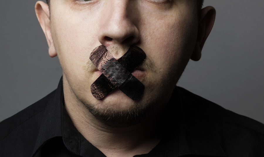 man with mouth covered by black patch to forbidden him the free speeching Black Censored Censorship Civil Rights  Forbidden Freedom Freedom Of Speech Headshot Lifestyles Men Mouth Mute Patch Quiet Secret Silent Speak Speech Stop Studio Tape