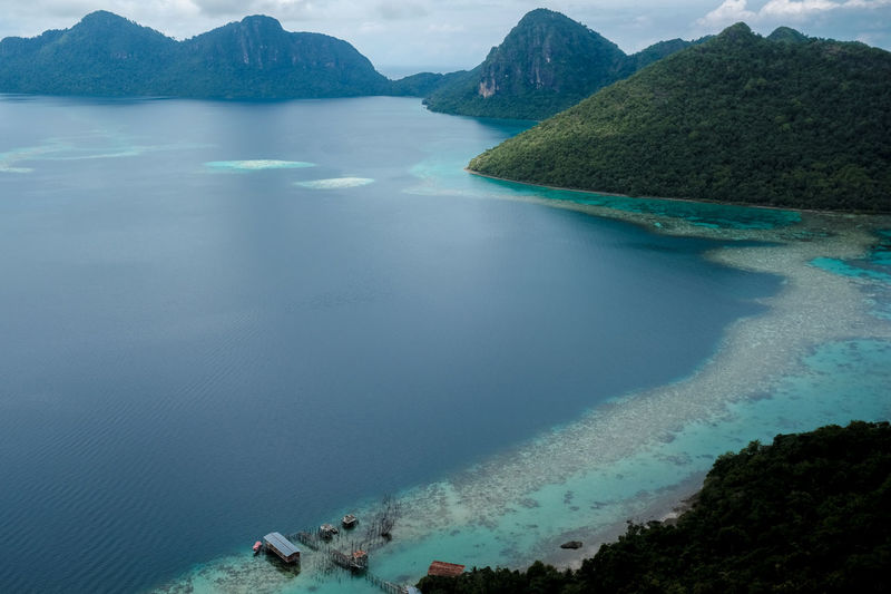 Bohey Dulang Island Beauty In Nature Day High Angle View Mountain Nature No People Outdoors Scenics Sea Sky Tranquil Scene Tranquility Water