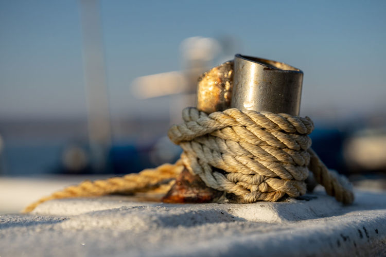 Close-up of rope tied on metal in boat