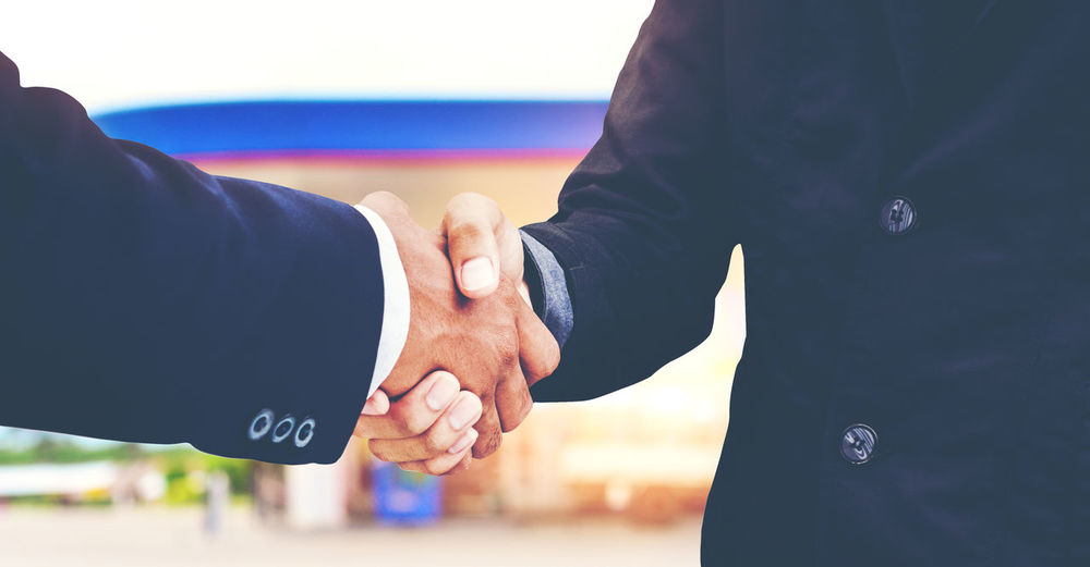 Successful businessman Pleased after the deal Bonding Celebration Emotion Event Hand Handshake Holding Hands Human Body Part Human Hand Positive Emotion Togetherness Two People