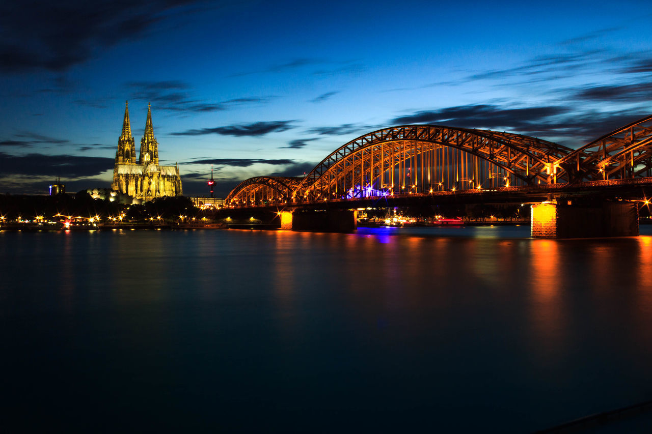 bridge - man made structure, connection, architecture, built structure, night, sky, illuminated, river, water, no people, waterfront, travel destinations, building exterior, blue, outdoors