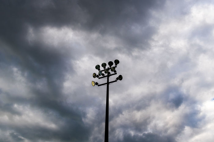 Cricket Field Stadium Lights Strom Cloud - Sky Communication Day Direction Floodlight Football Stadium Guidance Low Angle View Nature No People Outdoors Sky Storm Cloud Street Light Weather Weather Vane